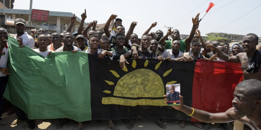 Pro-Biafra supporters shout slogans in Aba, southeastern Nigeria, during a protest calling for the release of a key activist on November 18, 2015. The protesters support the creation of a breakaway state of Biafra in the southeast and want the release of Nnamdi Kanu, who is believed to be a major sponsor of the Indigenous People of Biafra (IPOB) and director of the pirate radio station Radio Biafra. AFP PHOTO / PIUS UTOMI EKPEI        (Photo credit should read PIUS UTOMI EKPEI/AFP/Getty Images)