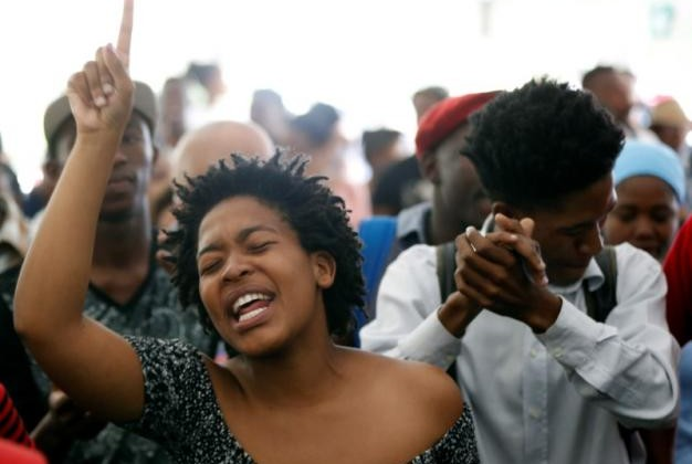 Students sing struggle songs during a gathering as Academic staff and church leaders protest demanding free tertiary education at Johannesburg's University of the Witwatersrand, South Africa, October 7, 2016. REUTERS/Siphiwe Sibeko